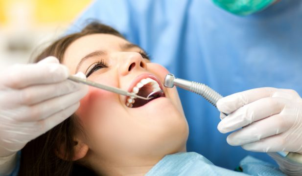 Girl getting teeth cleaning
