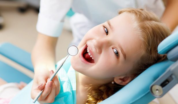 Girl getting treatment smiling