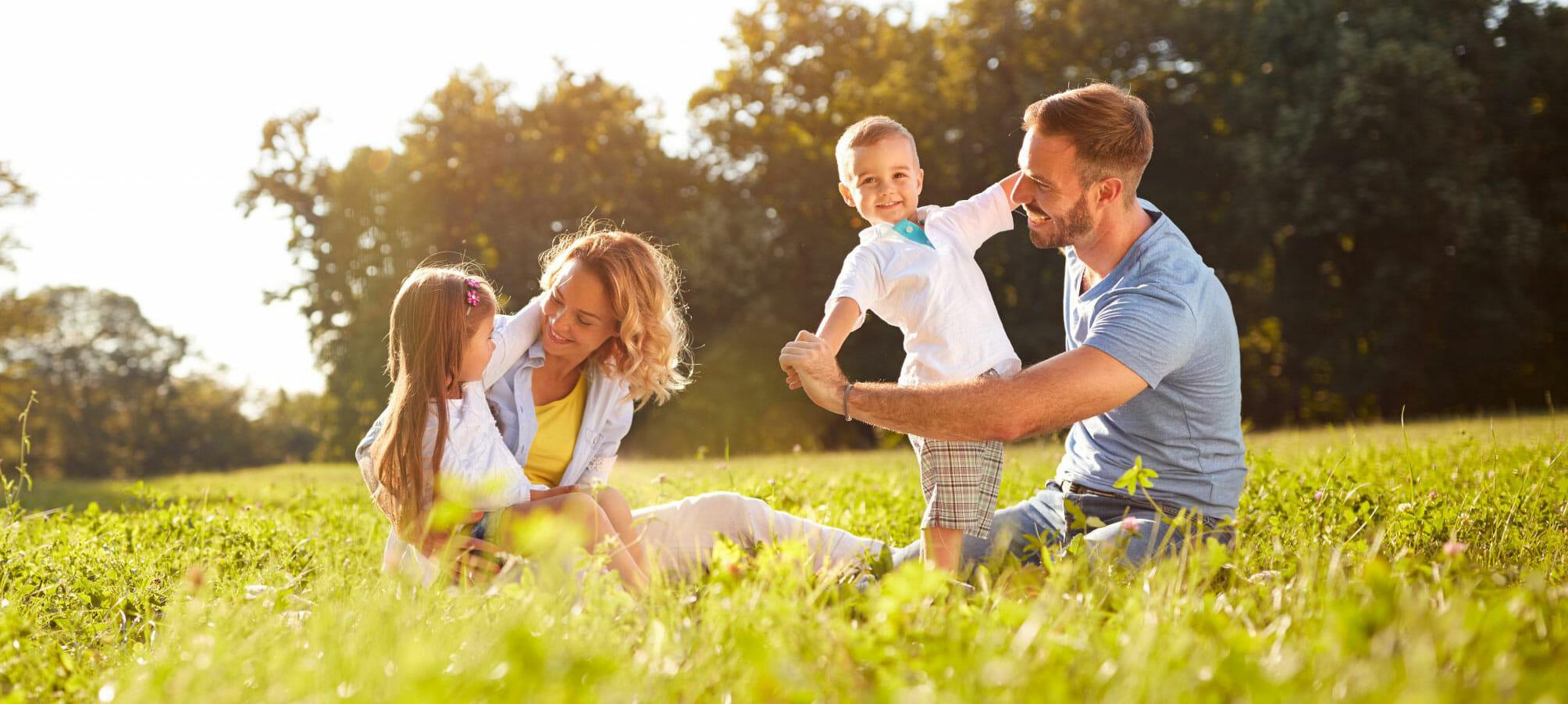 Family in park smiling