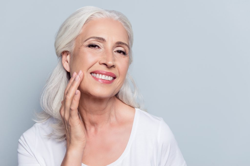 older woman pleased with her dentures