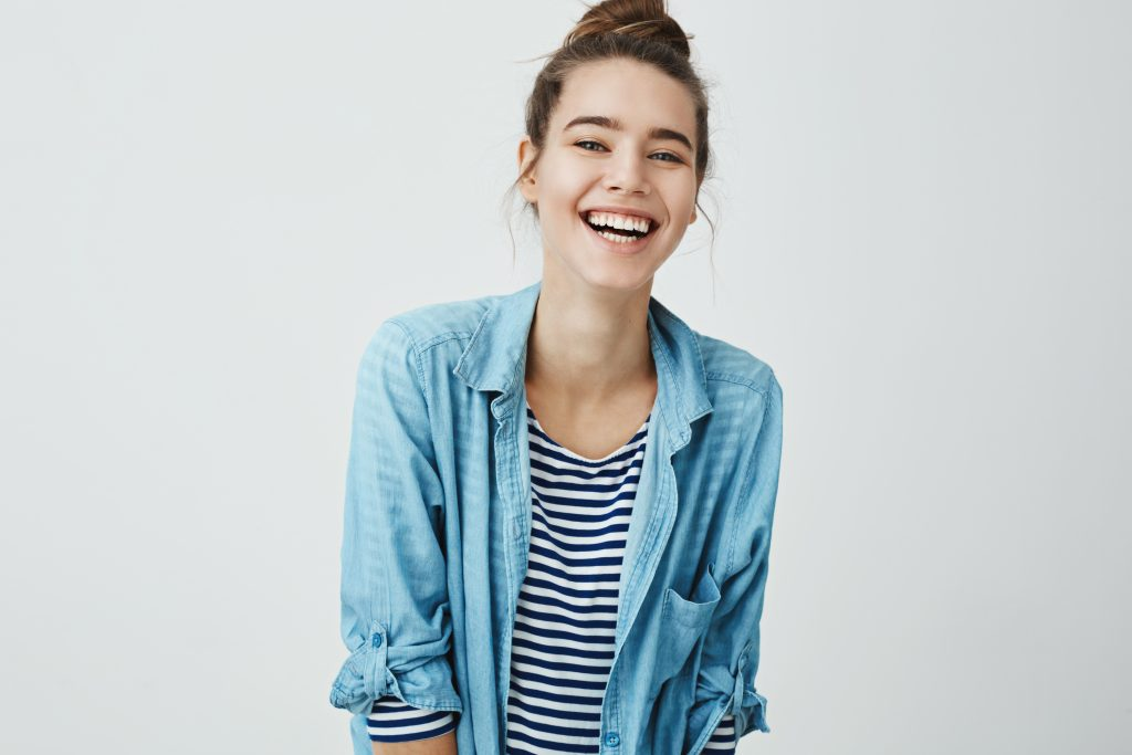 Young woman with hair in bun smiling