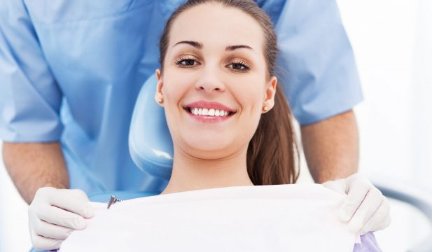 Woman Smiling in Dentist Chair